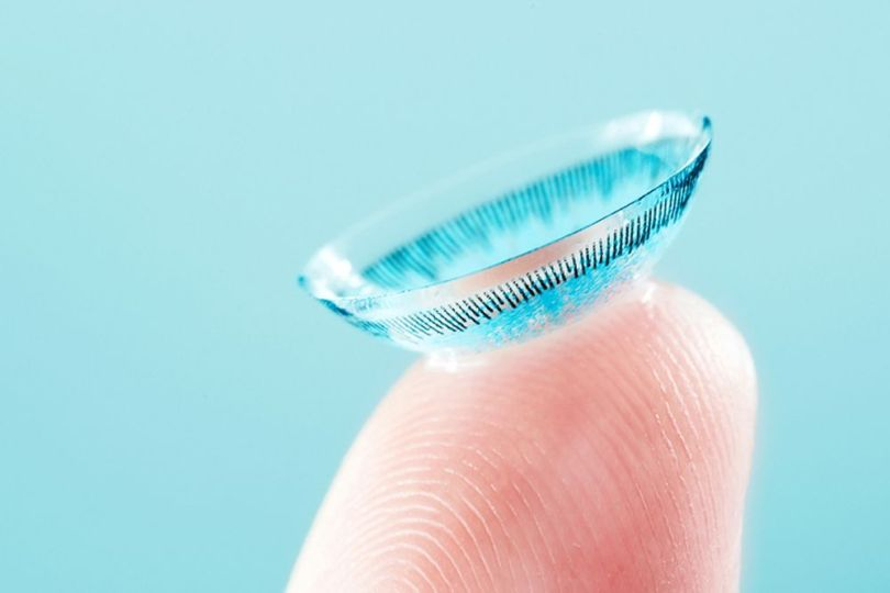 contact lens on finger